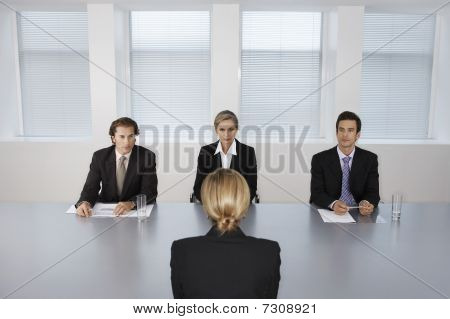 Businesswoman Giving Presentation to Executive Team