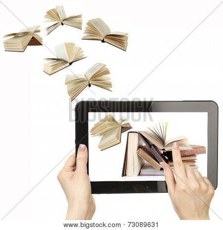 Information transfer. Books flying in tablet isolated on white