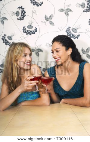 Friends toasting Martinis at table