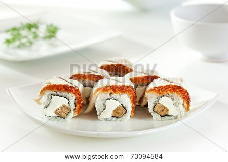 Maki Sushi - Roll made of Japanese Omelet and Cream Cheese  inside. Smoked Eel outside