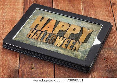 Happy Halloween typography - letterpress  wood type printing blocks on a digital tablet