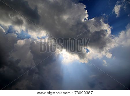 sun rays on dramatic sky wth storm clouds