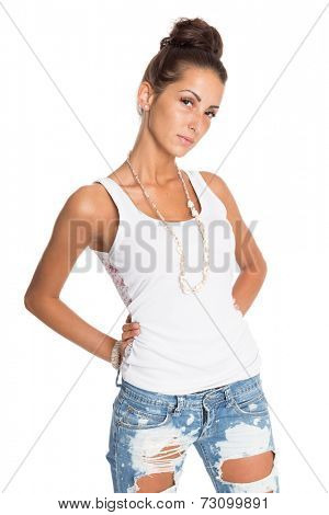 Pretty girl in jeans and a white T-shirt. Isolation on a white background.