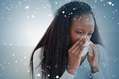 foto of blanket snow  - Composite image of close up of woman blowing her nose against snow - JPG