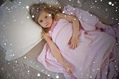 foto of blanket snow  - Composite image of high angle portrait of cute girl resting on sofa against snow - JPG