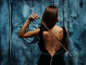 stock photo of art gothic  - Woman in dress with violin body art holding bow - JPG