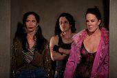 stock photo of pimp  - Frightened prostitutes in dark hallway with pimp - JPG