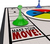 stock photo of competition  - Make Your Move words on a board game and a piece moving forward to keep progress in competition - JPG