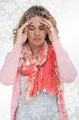 stock photo of silver-hair  - Blonde girl touching her temples because of a headache against snowflakes on silver - JPG