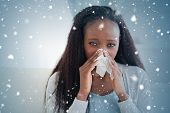 image of blanket snow  - Composite image of close up of woman on sofa blowing her nose against snow falling - JPG