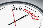 foto of time flies  - An image of a typical clock with text time runs in german language - JPG