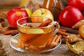 stock photo of cider apples  - Composition of  apple cider with cinnamon sticks - JPG