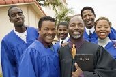 stock photo of preacher  - Preacher and Choir in church garden portrait - JPG