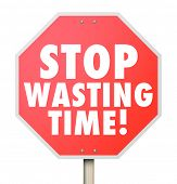 stock photo of waste management  - Stop Wasting Time words on a red road warning sign to help you better manage your hours and minutes for more efficiency and productivity - JPG