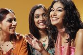 stock photo of three sisters  - Portrait of three women smiling - JPG