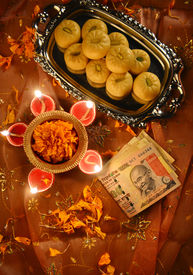 pic of laxmi  - worshiping Indian currency notes as a god of wealth during Diwali Festival - JPG