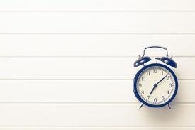 foto of analog clock  - top view of analog retro alarm clock - JPG