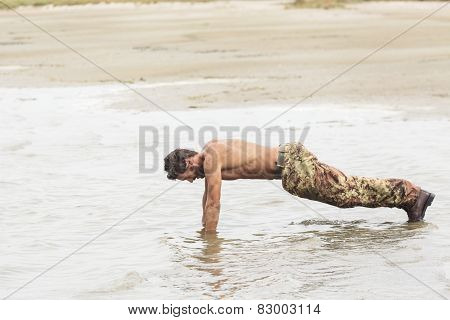 Athletic Army Doing Push Up Exercise At The Sea