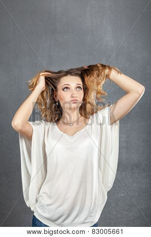 Casual Young Woman Playing With Hair