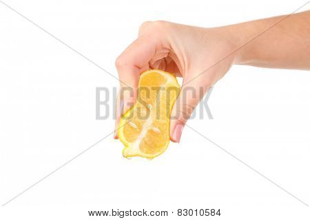 Female hand squeezing lemon isolated on white