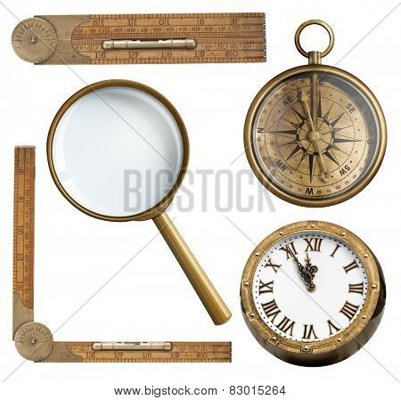 Vintage accessories set. Clock, magnifying glass, compass and ruler isolated