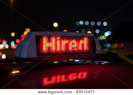 Hired Taxi Sign At Night