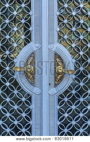 Golden Vintage Door Handles On Glass And Metal Decorative Doors