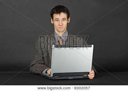 Man Working With Laptop Computer