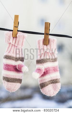 Baby gloves hanging on the clothesline.
