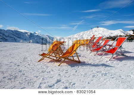 Colored Canvas chairs in snow