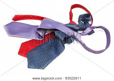 three tie knotted on a white background