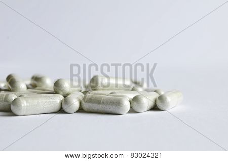 Close-up Gray Capsules On A White Background