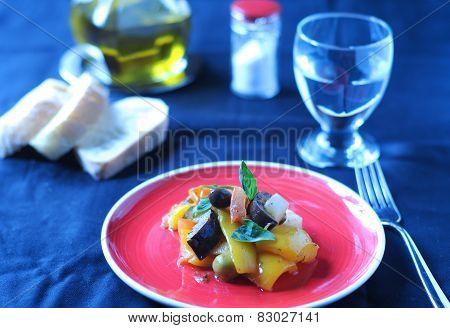 Caponata typical italian dish with potato pepper