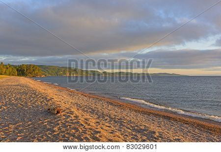 Evening Shadows On A Gravel Beach