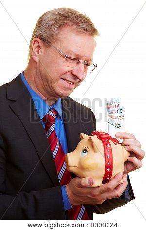 Businessman Saving Euro Banknotes