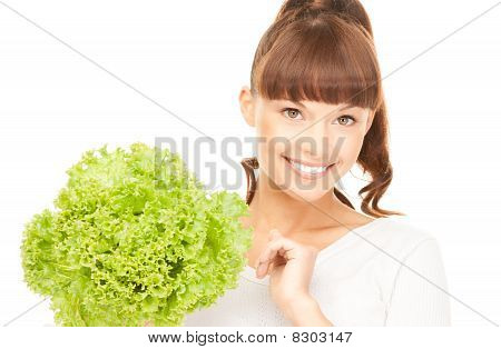 Beautiful Housewife With Lettuce Over White
