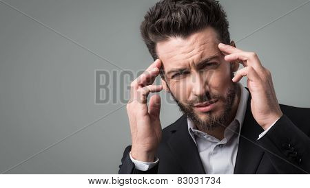 Businessman With Headache Head In Hands