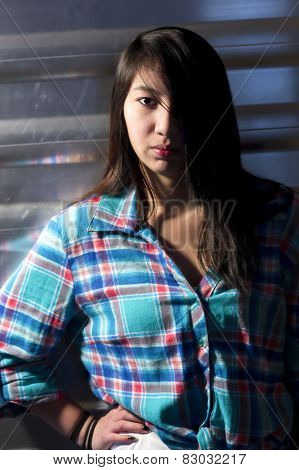 Side Lighting On Young Woman.