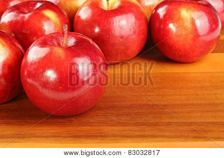 Red Tasty Apples On Wooden Table
