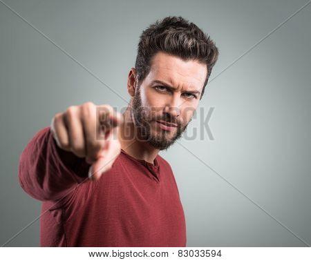 Angry Young Man Pointing At Camera