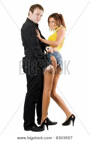 Young Man Rending Shorts Of Playful Woman