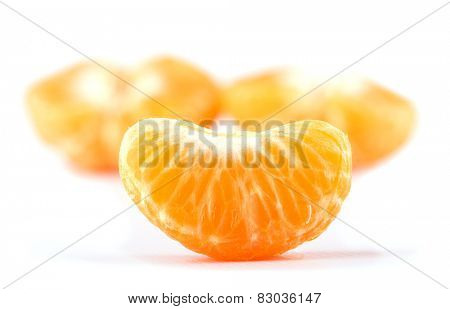 Slice of Clementine orange, with two halves on the background, on white