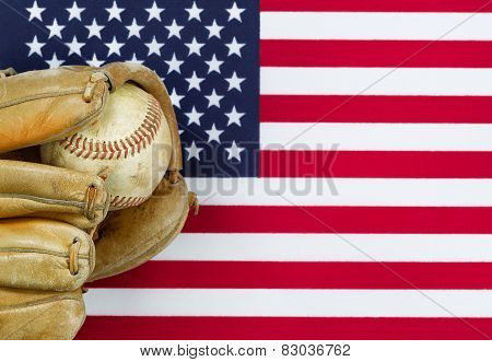 Worn Baseball Glove And Ball On American Flag