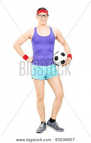 Full length portrait of a nerdy athlete holding a football isolated on white background