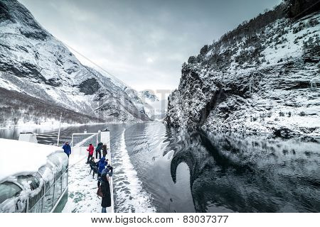 NORWAY- BERGEN - DECEMBER, 28: tourist ferry passes through the famous throughout the world Norwegian fjords, on December 28, 2014. Bergen. Norway
