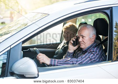 Older Driver Using Smartphone
