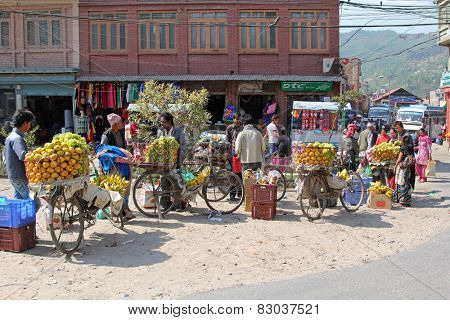 SANGA, NEPAL - APRIL 2014 : Nepalese venders selling fresh fruit on bicycle in Sanga, Nepal on 19 April 2014.
