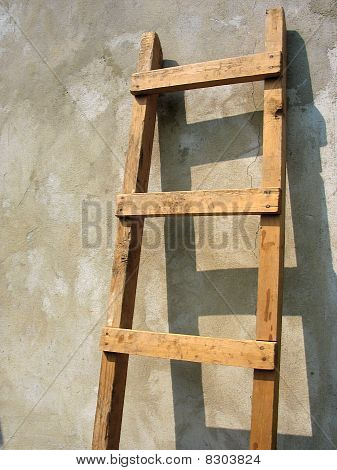 Old Wooden Ladder Over The Wall