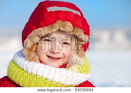 Winter Portrait Of A Cute Little Girl With White Frost On Her Hair