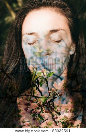Romantic double exposure portrait combined with photograph of apple tree flowers